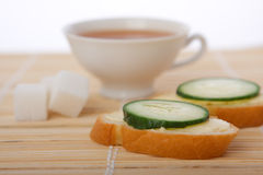 Breakfast tea and sandwiches Stock Photos