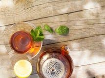 Breakfast tea on table in sunny garden Royalty Free Stock Image