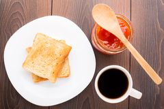 Breakfast with tea, toast and apricot jam Stock Images