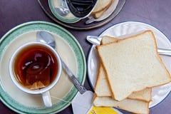 Breakfast. Tea with toast on table Stock Photos