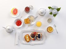 Breakfast with tea, toasts, butter, juice, jam and grapefruit  on white. 3D illustration. Breakfast with lemon tea, toasts, butter, juice, jam and grapefruit  on Stock Images