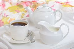 Breakfast Tea Tray. Breakfast tray filled with teapot, milk jug and tea cup Stock Photography