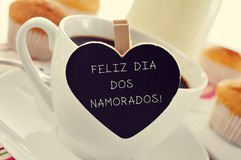 Breakfast and text Feliz Dia Dos Namorados, in portuguese, for t. Text Feliz Dia Dos Namorados, written in portuguese in a heart-shaped blackboard, for the Royalty Free Stock Photo