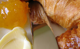Breakfast time 2. Croissant, butter, marmalade and knife - perfect continental breakfast stock images