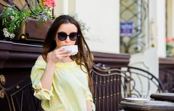 Breakfast time in cafe. Girl enjoy morning coffee. Woman drink coffee outdoors. Peaceful inspiring moment. Girl relax in. Cafe cappuccino cup. Caffeine dose royalty free stock image