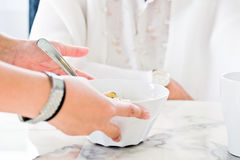 Breakfast time. Carer bringing meal to senior,meal time. part of senior woman with breakfast, Senior healthy eating Royalty Free Stock Images