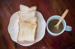 Breakfast time with coffee and bread Stock Photography