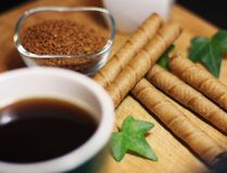 Breakfast time with coffee cup and chocolate sticks royalty free stock photography