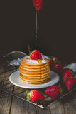 Breakfast Time with Fresh Strawberry on Stack of Pancake Pouring Stock Images