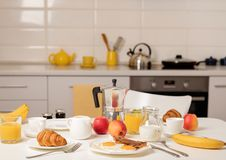 Free Breakfast Time. Fried Eggs And Bacon. Croissants And Orange Juice, Jam. Coffee With Cream Or Milk. Fruits - Bananas, Red And Stock Photography - 131962032