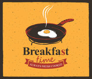 Breakfast time with a frying pan and fried eggs Royalty Free Stock Photography
