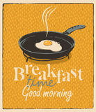 Breakfast time with a frying pan and fried eggs Stock Images