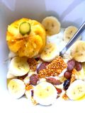 Breakfast time. Pinapple sesame seeds bananas yoghurt royalty free stock photos