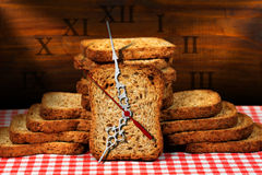 Breakfast Time - Rusks with Clock Royalty Free Stock Photography