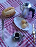 A breakfast time in up-contry. A breakfast in a Brazil whit tradicional plates like coffe, pão de queijo, bread and milk Stock Images