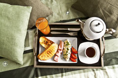 Breakfast to bed. Healthy breakfast served to bed: toasted bread, ham, cottage cheese, tomatoes, tea and orange juice Stock Images