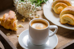 Breakfast to bed with hot coffee and a croissant Royalty Free Stock Image