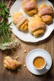Breakfast to bed with hot coffee and a croissant Royalty Free Stock Photos