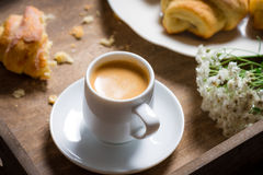 Breakfast to bed with hot coffee and a croissant Royalty Free Stock Images