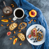 Breakfast with toast, berries and nuts on dark background. Healthy dessert Flat lay, Top view. Breakfast with toast, berries and nuts on dark background. Healthy Stock Image