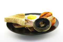 Breakfast and Toast on a Black Plate Royalty Free Stock Photography