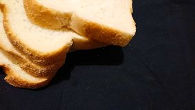 Breakfast toast. Bread on a black background royalty free stock photography