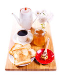 Breakfast with toast bread, honey and coffee on wooden board Royalty Free Stock Photo