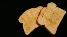 Breakfast toast. On a black background stock photography