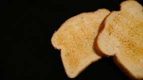 Breakfast toast. On a black background royalty free stock image