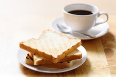 Breakfast with toast and coffee on wooden table. In the morning Royalty Free Stock Photography
