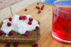 Breakfast with toast with creamcheese berries. And fruit tea royalty free stock photo