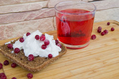 Breakfast with toast with creamcheese berries and fruit tea. Breakfast with toast with creamcheese berries and tea royalty free stock photography