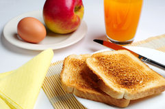 Breakfast with toast. Egg, apple and juice Stock Photos