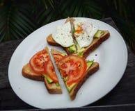 Breakfast. Toast eggs avocado morning food stock photos