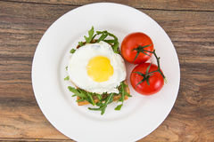 Breakfast toast with fried egg and arugula Stock Photography