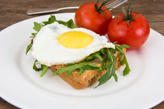 Breakfast toast with fried egg and arugula Royalty Free Stock Photography