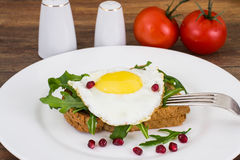 Breakfast toast with fried egg and arugula. Studio Photo Royalty Free Stock Photos