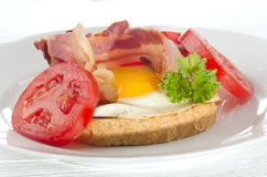 Breakfast with toast and fried egg. Breakfast with toast, bacon and fried egg Stock Image