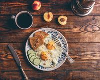 Breakfast toast with fried eggs with vegetables, coffee and frui stock photos