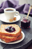 Breakfast with toast. Fruit jam and coffee on tray Stock Photo