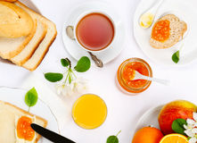 Breakfast with toast and jam. Breakfast with toast, jam, juice and tea Royalty Free Stock Image