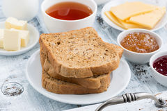 Breakfast with toast, jam and black tea stock image