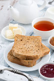 Breakfast with toast, jam and black tea, vertical Stock Photos