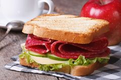Breakfast: toast with salami, coffee, red apple Royalty Free Stock Photo
