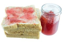 Breakfast of toast. Breakfast of thick sliced toast with apple strawberry jam and butter on the table Stock Photo