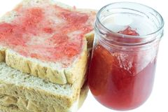 Breakfast of toast. Breakfast of thick sliced toast with apple strawberry jam and butter on the table Royalty Free Stock Photography