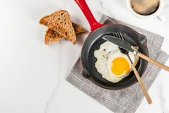 Breakfast with toasted bread and fried egg Royalty Free Stock Image