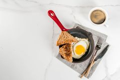 Breakfast with toasted bread and fried egg Royalty Free Stock Photography