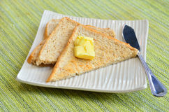 Breakfast with toasts and butter Royalty Free Stock Images
