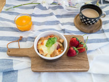 Breakfast with toasts, egg, coffee and fruits Stock Photos
